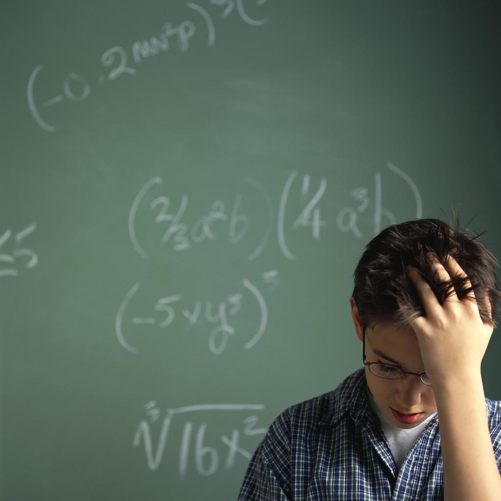 Schoolboy Struggling with Math Problems